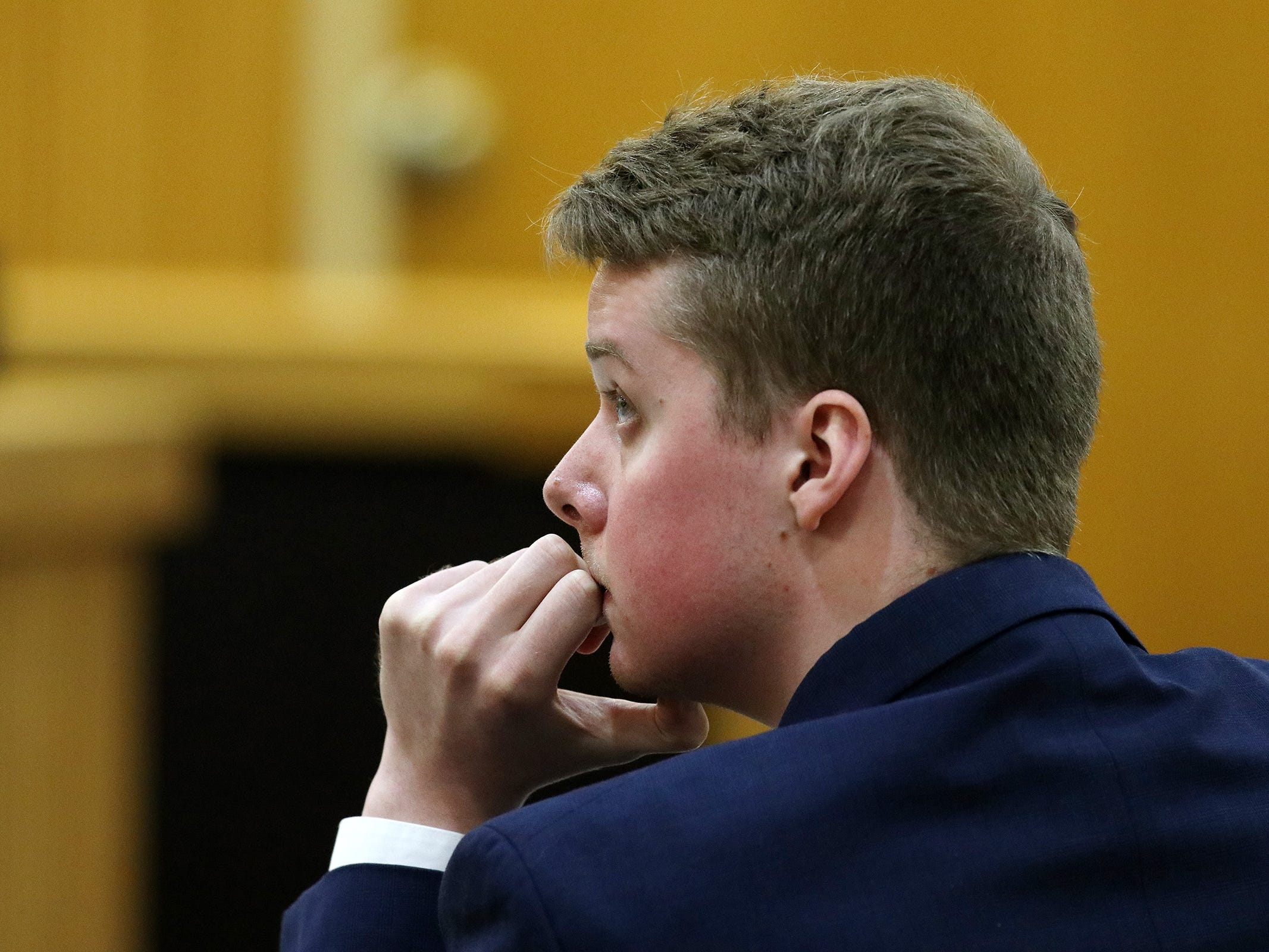 Liam McAtasney, who is charged with the murder of former high school classmate, Sarah Stern, listens to Carlos Diaz-Cobo, defense attorney, make his closing arguments during trial before Superior Court Judge Richard W. English at the Monmouth County Courthouse in Freehold, NJ Friday, February 22, 2019.