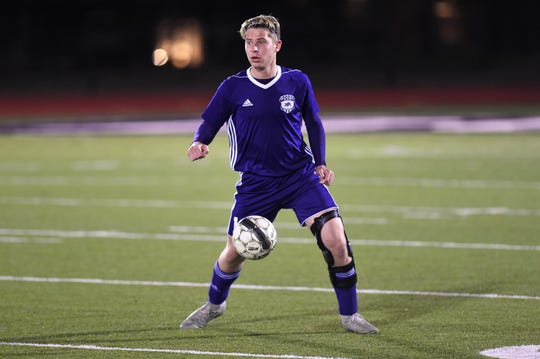 Wylie's Zane McCurley (10) settles the ball against Wichita Falls Rider in District 4-5A play at Bulldog Stadium on Feb. 22, 2019.