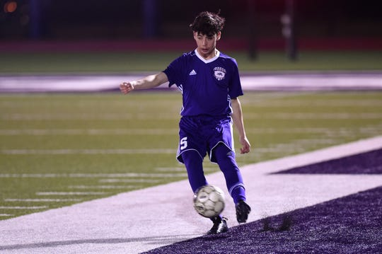 Wylie's Andrew Kerestly (5) makes a pass against Wichita Falls Rider in District 4-5A play at Bulldog Stadium on Feb. 22, 2019.