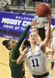 ACU's Sara Williamson right, drives to the basket against a Southeastern Louisiana defender during their Southland Conference game Saturday, Feb. 23, 2019, at Moody Coliseum.