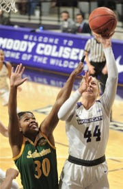 ACU's Lexie Ducat, right, shoots over Southeastern Louisiana's Ashailee Brailey during the first half of the Southland Conference game Saturday.