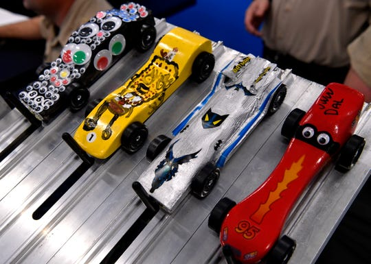 Customized racers are ready to roll Saturday at the Pinewood Derby.