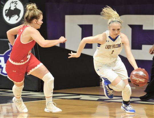 Veribest's Catlyn Ward, right, brings the ball upcourt as Hermleigh's Lynzie Stewart defends. Hermleigh won the Region II-1A girls basketball semifinal game 44-39 on Friday, Feb. 22, 2019, at ACU's Moody Coliseum.