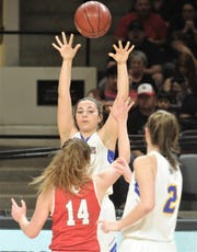 A Veribest player passes the ball to a teammate while Hermleigh's Ciera Digby (14) defends during their Region II-1A girls basketball semifinal game Friday,  Feb. 22, 2019, at ACU's Moody Coliseum.
