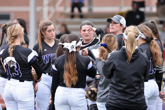 Wylie coach Heather Collier talks to her team against Big Spring at Lady Bulldog Field on Feb. 22, 2019.