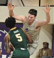 ACU's Hayden Farquhar, right, draws a charge from Southeastern Louisiana's Kajon Brown in the first half of the Southland Conference game Saturday, Feb. 23, 2019, at Moody Coliseum.