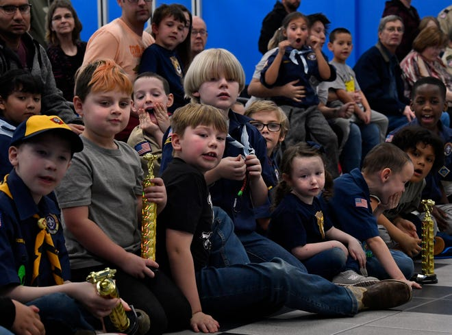 Scouts watch the finish line during Saturday's Pinewood Derby at Lawrence Hall Supercenter.