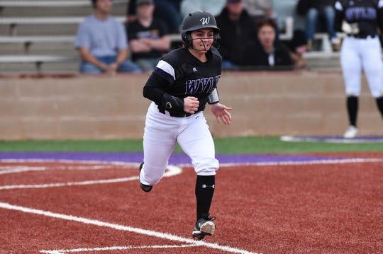 Wylie's Madison Owen (2) runs to first base against Big Spring at Lady Bulldog Field on Feb. 22, 2019.