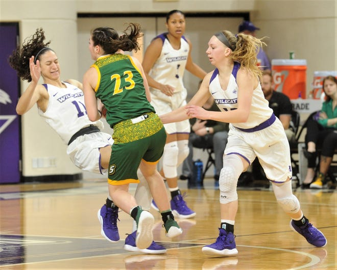 ACU's Sara Williamson, left, draws a charge from Southeastern Louisiana's Jaclyn Scholvin while teammate Breanna Wright, right, looks on during the fourth quarter of the Southland Conference game Saturday at Moody Coliseum.