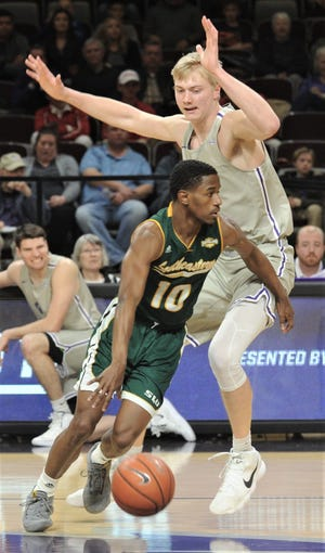 Southeastern Louisiana's Von Julien, a 6-foot guard, dribbles around ACU's Kolton Kohl, a 7-foot center, during the first half of the Southland Conference game Saturday, Feb. 23, 2019, at Moody Coliseum.