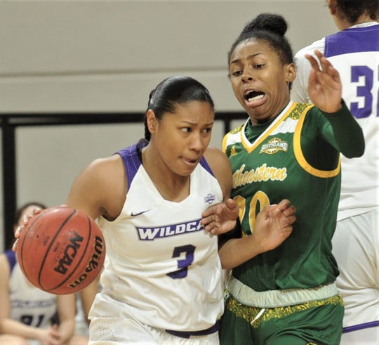 ACU's Dominique Golightly, left, drives around Southeastern Louisiana's Celica Sterling in the fourth quarter of the Southland Conference game Saturday.