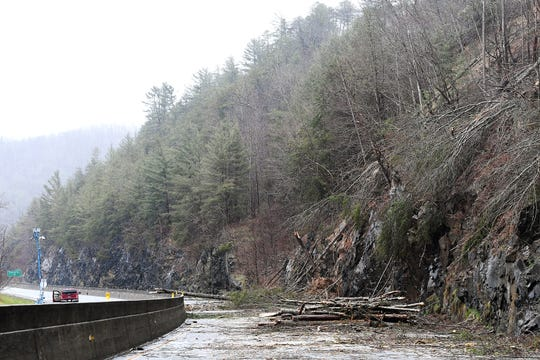 Rocks, trees and other debris cover I-40 at mile marker 7.5 on Feb. 23, 2019. A rockslide Friday night that continued into Saturday closed the highway in both directions. The NC Department of Transportation expects I-40 to be closed for a week as they clean up and stabilize the area which still had falling trees and rocks Saturday afternoon.