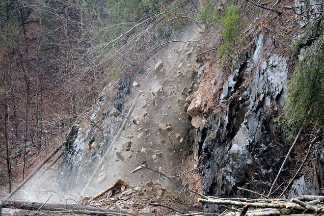 Rocks, trees and other debris falls onto the roadway of I-40 at mile marker 7.5 on Feb. 23, 2019. A rockslide Friday night that continued into Saturday closed the highway. The NC Department of Transportation expects I-40 to be closed for a week as they clean up and stabilize the area which still had falling trees and rocks Saturday afternoon.