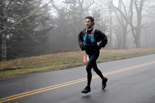 Asheville's Luke Paulson, who won the Mount Mitchell Marathon, arrives first to the Blue Ridge Parkway on Feb. 23. With the Challenge and Black Mountain Marathon in the books, several races are right around the corner.