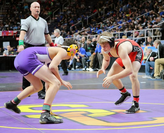 Norwich's Dante Geislinger, right, opposes Honeoye Falls Lima's Nicholas Noto in a 106-pound quarterfinal Friday in the NYSPHSAA Tournament at Times Union Center in Albany.