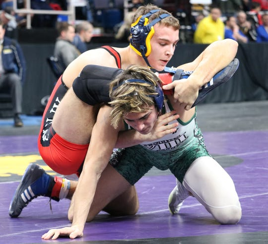 Tioga's Austin Lamb, top, wrestles Cold Spring Harbor's Ray Acosta in a D-II 145-pound semifinal Friday in the NYSPHSAA Tournament at the Times Union Center in Albany. Lamb won, 3-2.