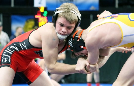 Norwich junior Dante Geislinger, left, wrestles Cooperstown/Milford's Avery Leonard in a 106-pound state semifinal Saturday at Albany's Times Union Center.