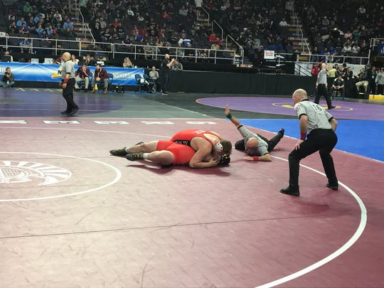 Newark Valley's Trentyn Rupert pins Tioga's Stephen Taylor in the DII 285-pound semifinal.