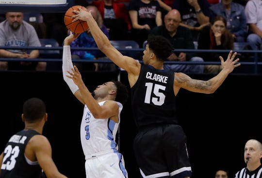 Gonzaga forward Brandon Clarke (15) blocks a shot by San Diego guard Olin Carter III during the second half of an NCAA college basketball game Saturday, Feb. 16, 2019, in San Diego.