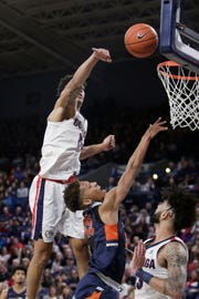 Gonzaga forward Brandon Clarke, top, blocks a shot by Pepperdine forward Kessler Edwards, center, in front of Gonzaga guard Josh Perkins during the second half of an NCAA college basketball game in Spokane, Wash., Thursday, Feb. 21, 2019.