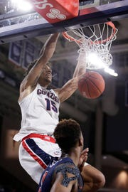 Gonzaga forward Brandon Clarke (15) dunks in front of Pepperdine guard Jade' Smith during the second half of an NCAA college basketball game in Spokane, Wash., Thursday, Feb. 21, 2019.