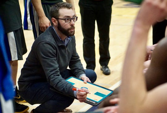 Olympic coach Jon O'Connor talks to his team during Saturday's regional basketball game against Fife.