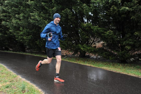 A 2019 Black Mountain Marathon runner makes his way along the Flat Creek Greenway on Feb. 23.