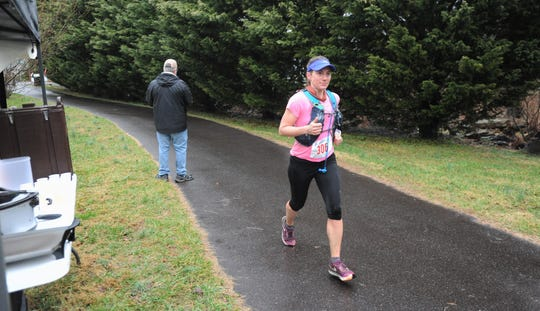 Cynthia Arnold, the top female finisher in the Black Mountain Marathon on Feb. 23, was the fourth runner to pass through the portion of the Flat Creek Greenway  where dozens of locals gathered to cheer.
