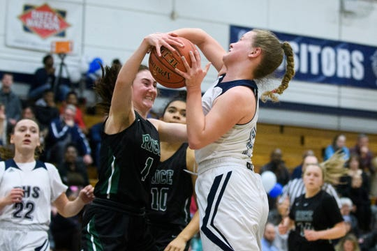 Rice's Kristne Varin (1) blocks the shot by Burlington's Ella Becker (11) during the girls basketball game between the Rice Green Knights and the Burlington Seahorses at BHS High School on Friday night February 22, 2019 in Burlington, Vermont.