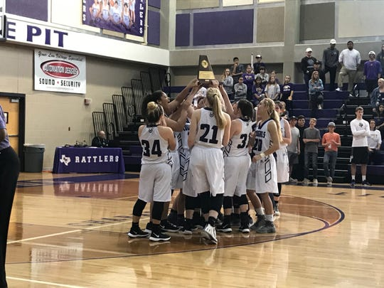 The Mason girls basketball team celebrates the Region IV-2A championship after a 46-36 win over San Saba at San Marcos High School's Snake Pit.