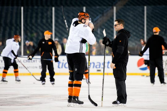 Flyers' James van Riemsdyk, left, is spoken with during practice Friday, Feb. 22, 2019 prior to a Stadium Series game with the Pittsburgh Penguins at Lincoln Financial Field in Philadelphia, Pa.