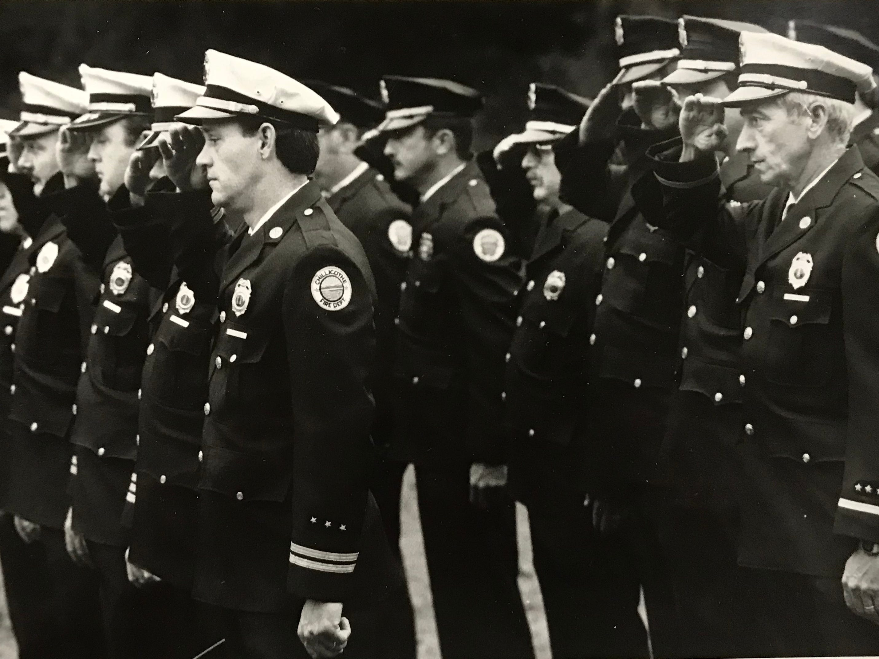 In October 1987, Chillicothe Fire Department Capt. Gordon Bauer, left, and Lt. Ronald Davis join other firefighters during the annual memorial service at the fire fighters memorial in Yoctangee Park. The memorial has since been re-located to outside Station 1 on Water Street.