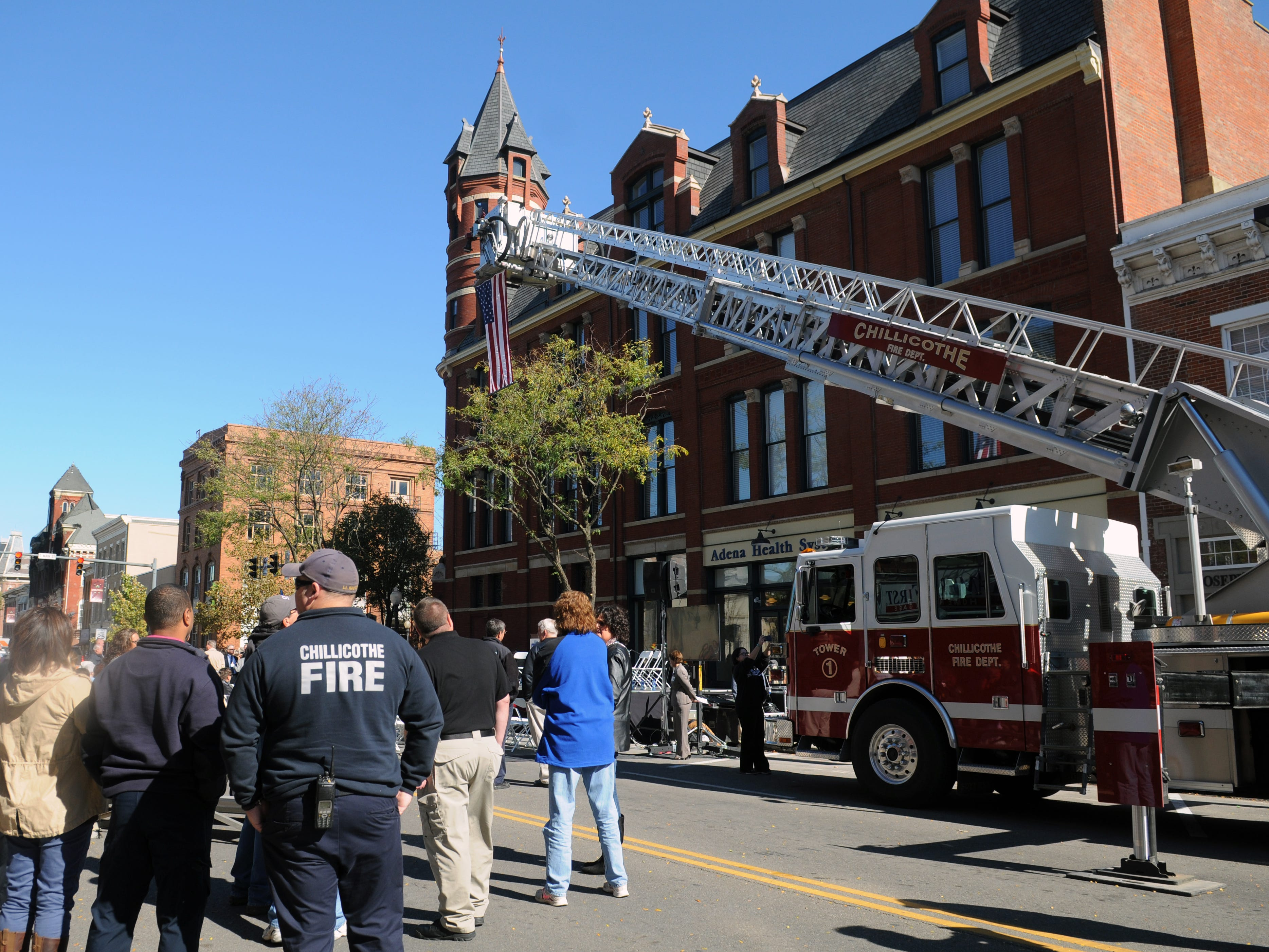 Members of the Chillicothe Fire Department gather before the reopening of the Carlisle building in October 2015.