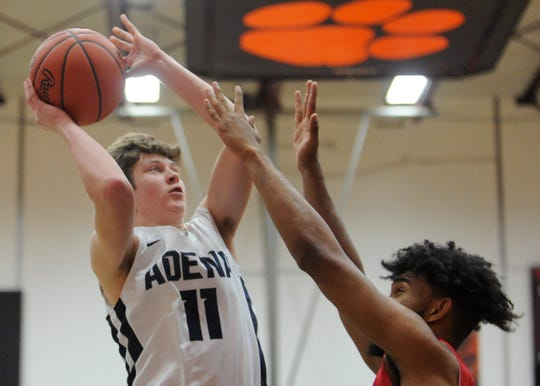Logan Bennett takes a shot over Portsmouth defender in sectional final game. Adena High School basketball went 6-16 during the 2017-18 season but this year they have completely turned it around as they are in a district semi.