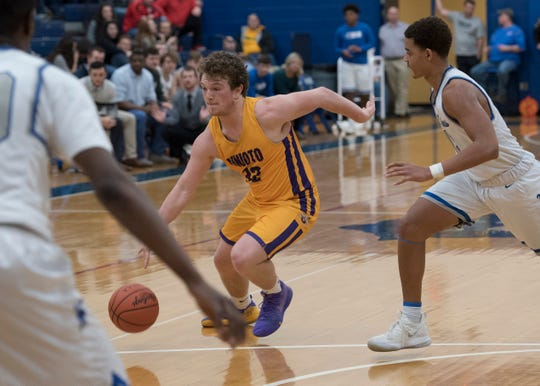 Unioto's Chance Smith drives the ball into the lane during a Division II sectional final at Southeastern High School during the 2018-19 season.