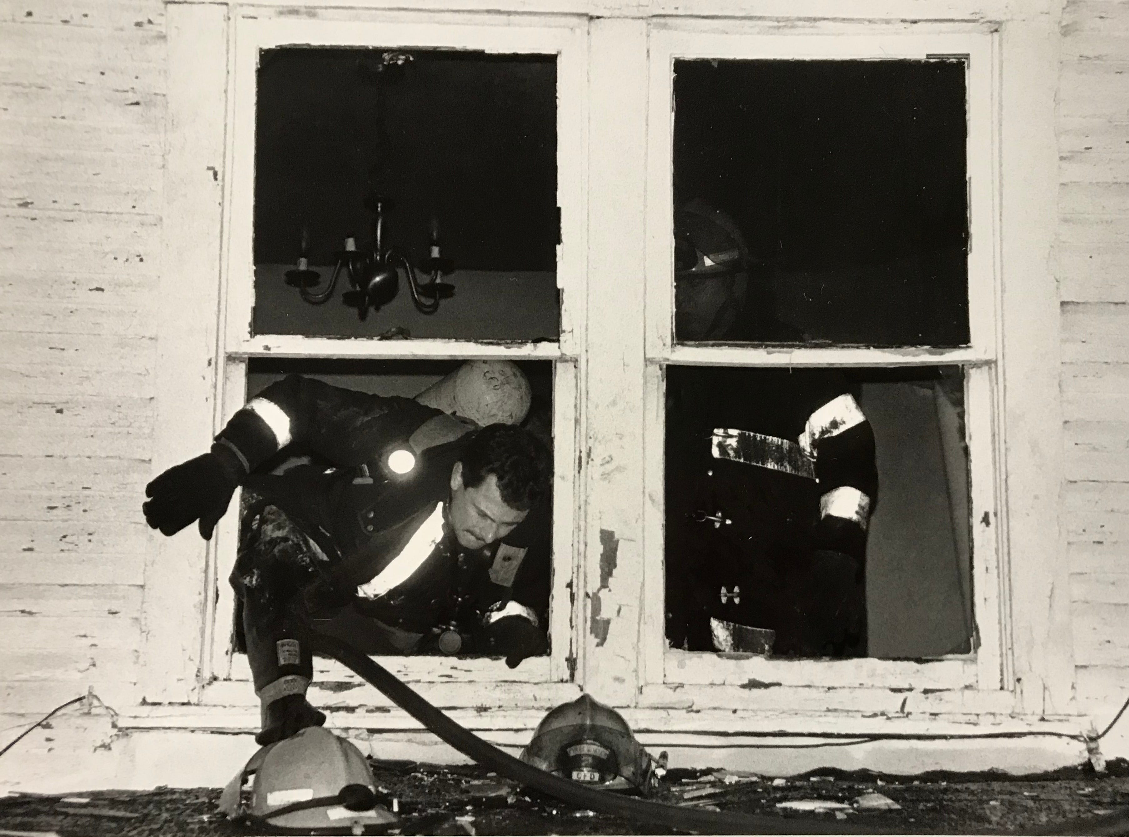 A Chillicothe firefighter emerges from a house on East Water Street in this undated Gazette file photo.