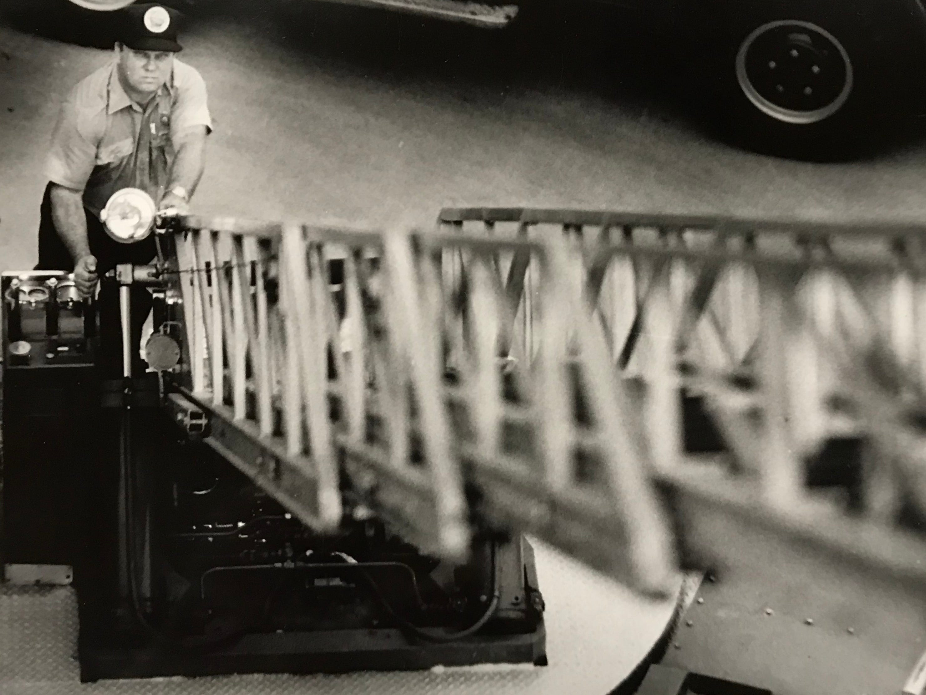 """Chillicothe Firefighter Carl """"Speedy"""" Tomlinson tests a ladder truck in August 1989."""