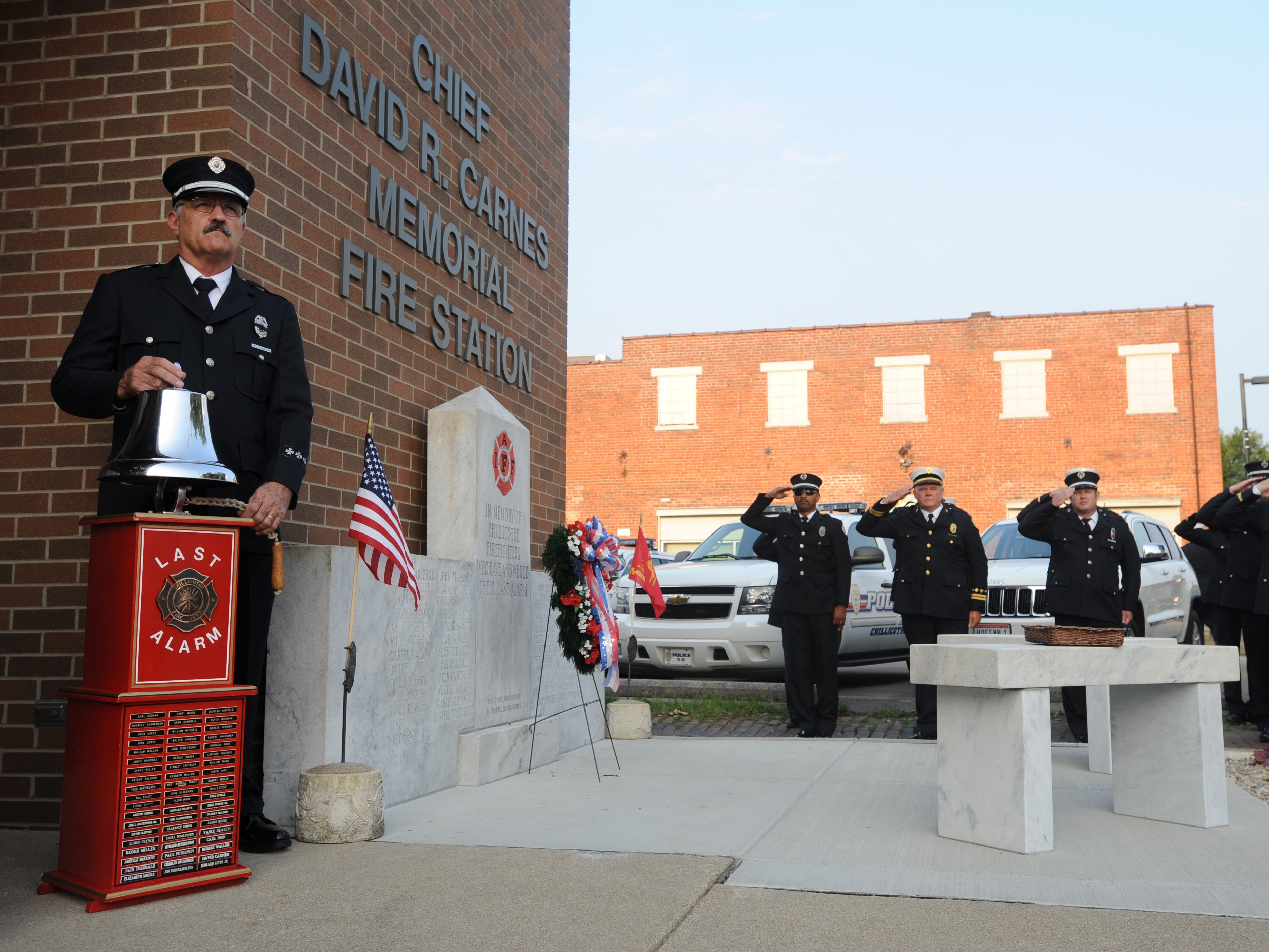 Retired firefighter Pete Pennington rings the 3-3-3 signal during the Chillicothe Fire Department's Firefighters' Memorial Service at Fire Station 1 on Water Street in September 2013. The 3-3-3, which historically signaled firefighters to return to station, was rung in honor of deceased firefighters.