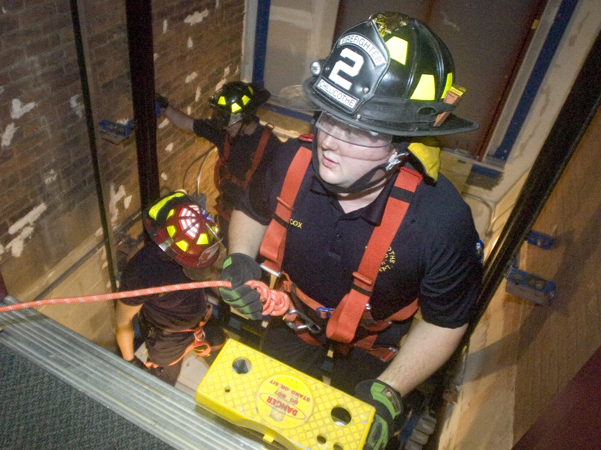 Bryon Cox enters the elevator shaft during a training exercise for the Chillicothe Fire Department in 2010 at Trinity United Methodist Church.