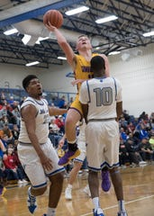 Unioto's Isaac Little puts the ball up during a Division II sectional final at Southeastern High School during the 2018-19 season.