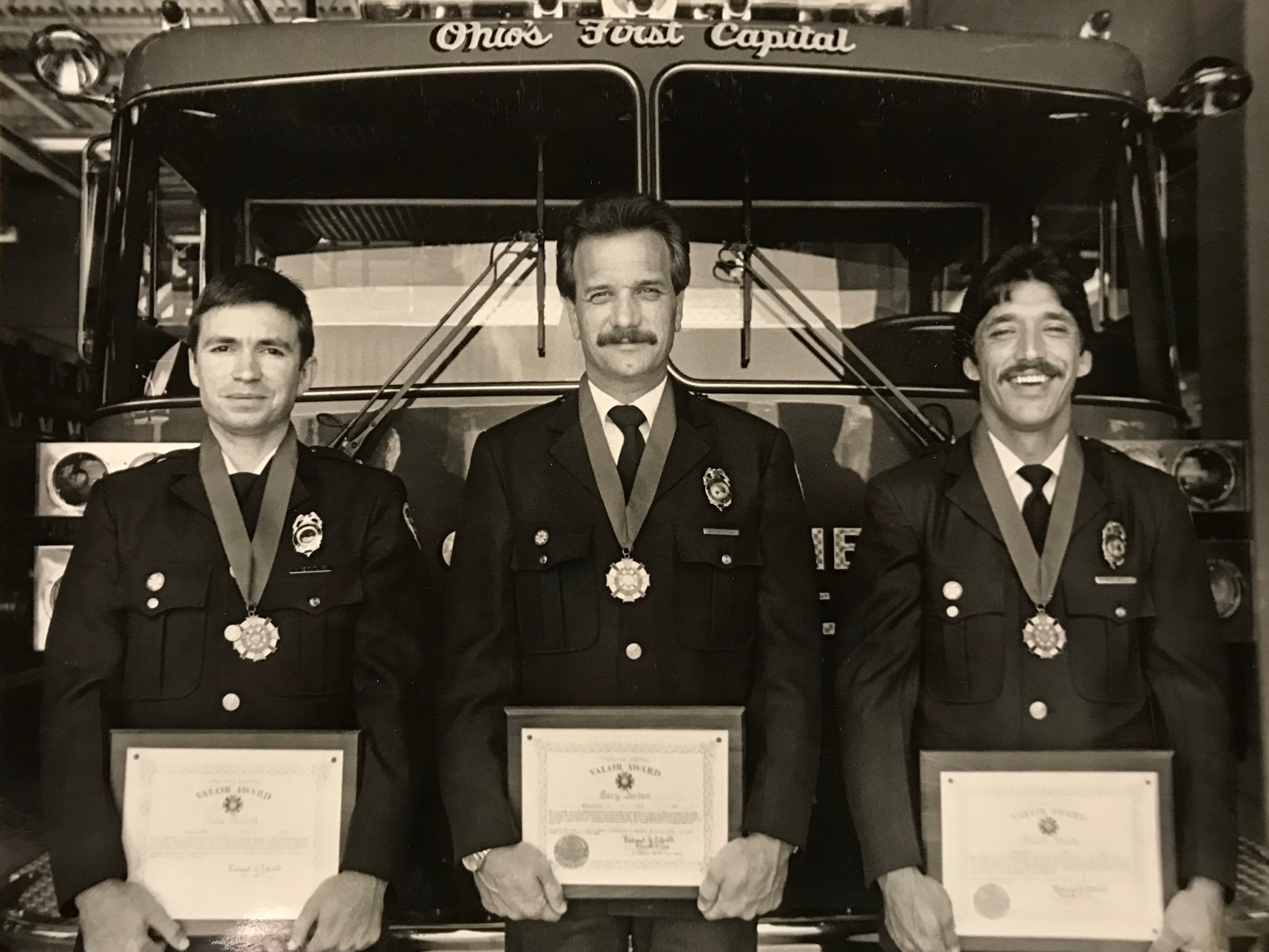 The State Fire Commission awarded, left-to-right, Mike Ratliff, Gary Jordan, and Frank Woods with the Valor Award for saving a woman and child trapped in a house fire earlier that year in January 1987.