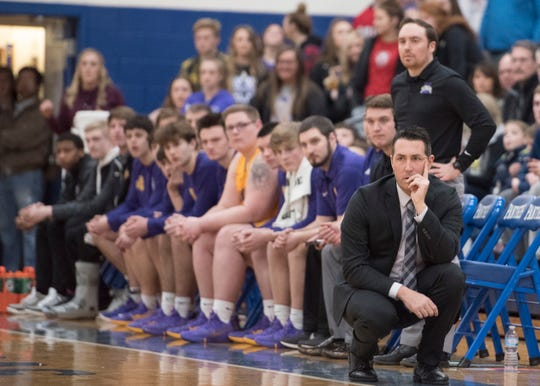 Unioto head coach Matt Hoops watches his team from the bench during a Division II sectional final at Southeastern High School during the 2018-19 season.