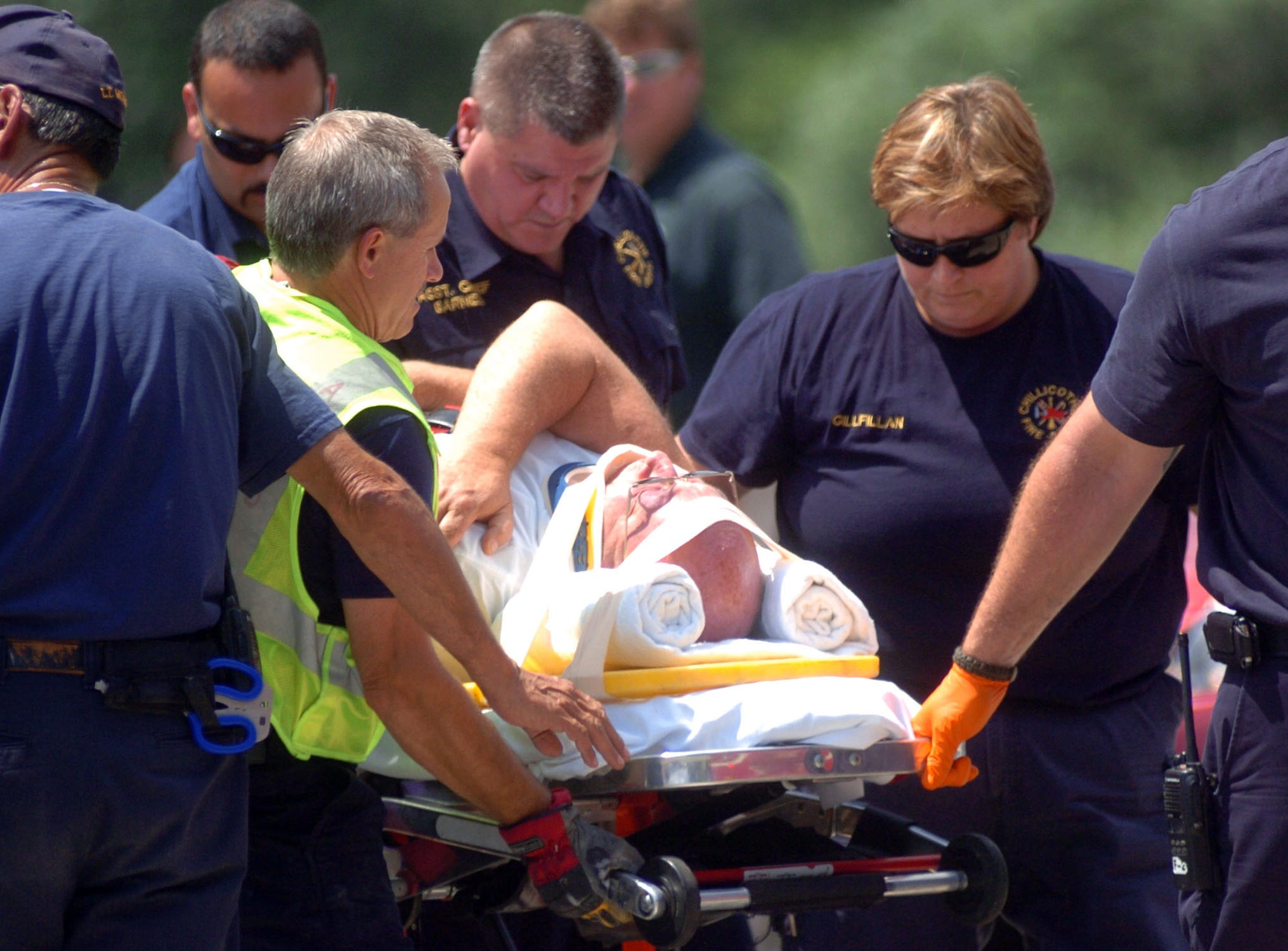 Members of the Chillicothe Fire Department lead a man to an ambulance after being involved in accident on the corner of Bridge Street and Riverside Street in 2010.   The accident occurred after a City Services vehicle hit a sheriff deputy heading on a call, involving two additional civilian vehicles.