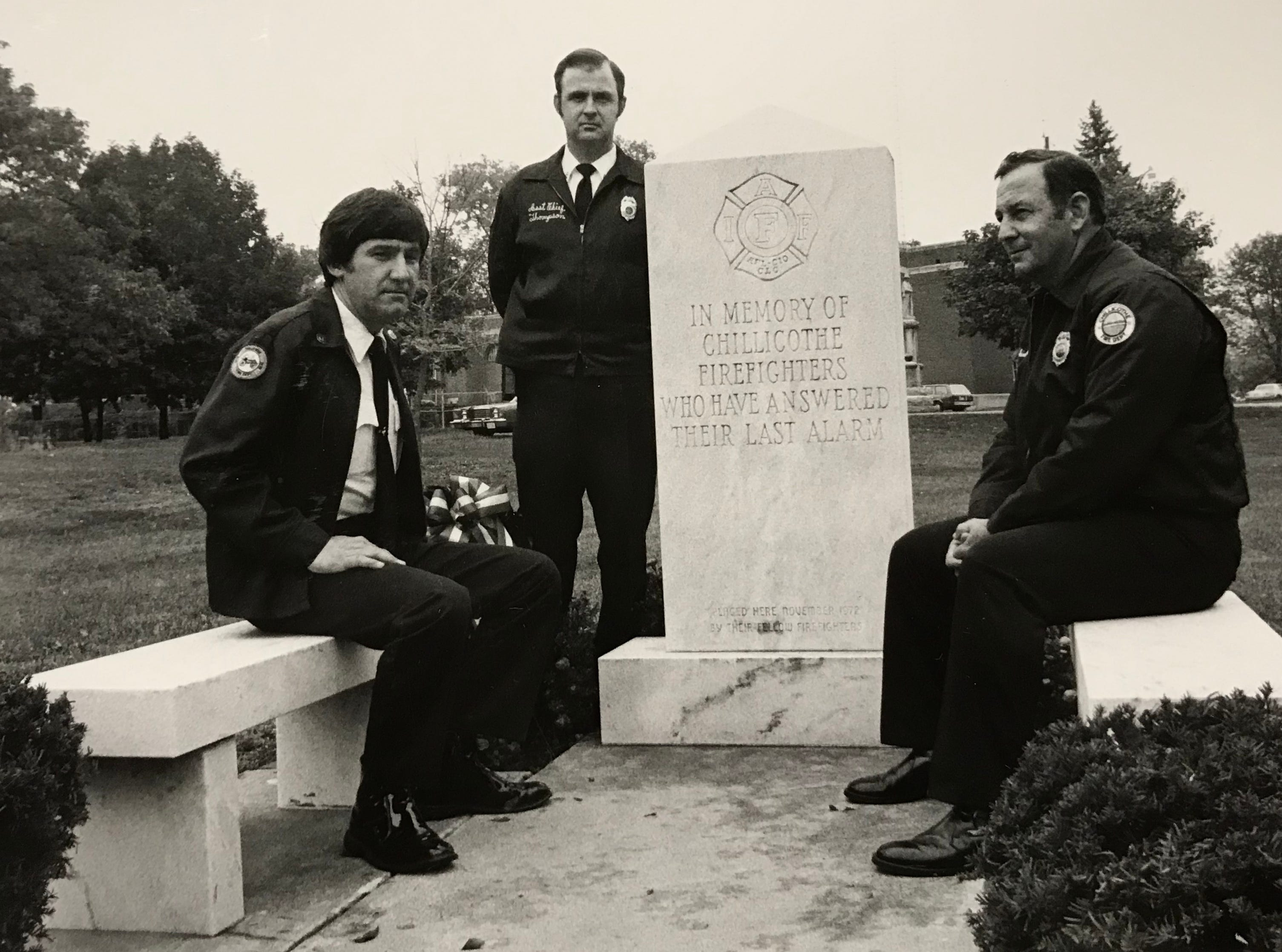 Chillicothe Fire Lt. Richard Copp, left, Lt. Larry Thomson, standing, and Chief David Carnes sit at the Chillicothe firefighters memorial in October 1984.