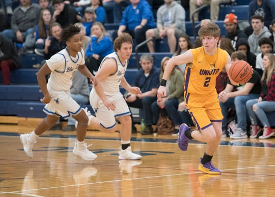 Unioto's Cameron DeBord dribbles the ball during a Division II sectional final at Southeastern High School during the 2018-19 season.