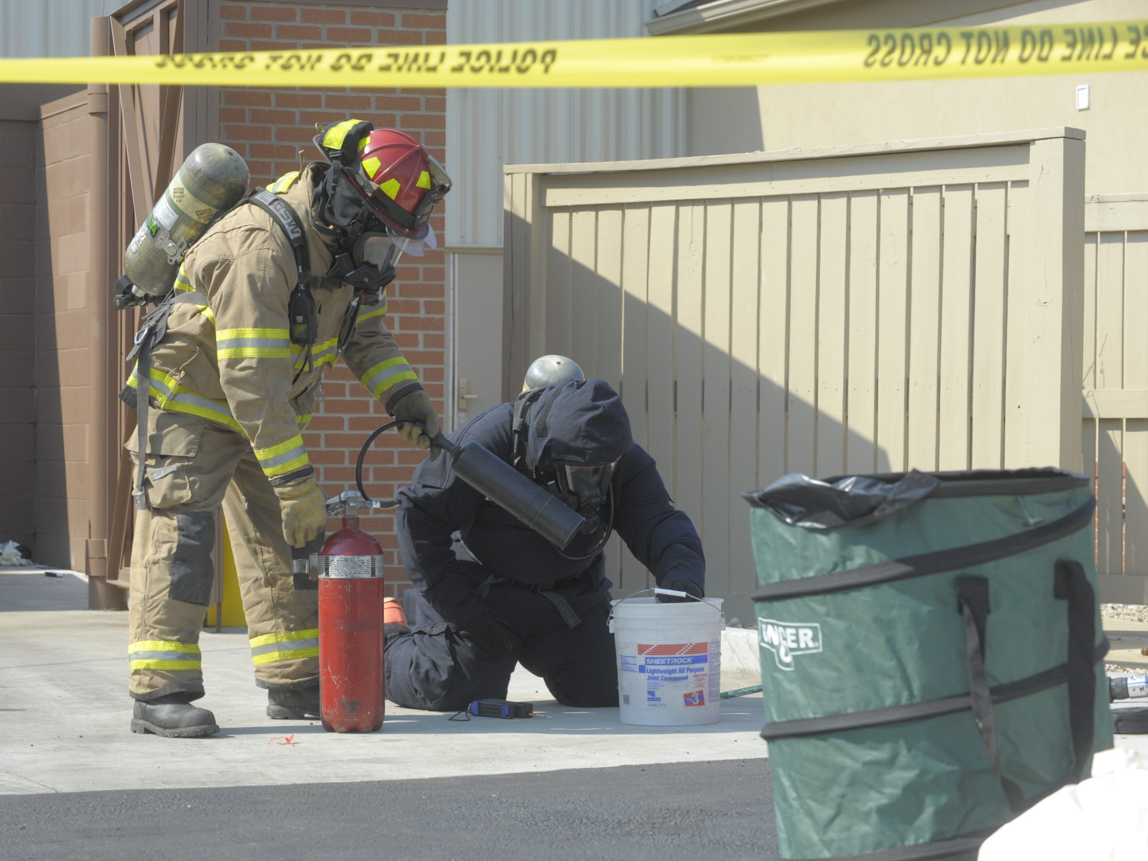 Chillicothe Fire Department Capt. Dave Russell and BCI Agent Dennis Lowe cleanup a meth lab in June 2012.