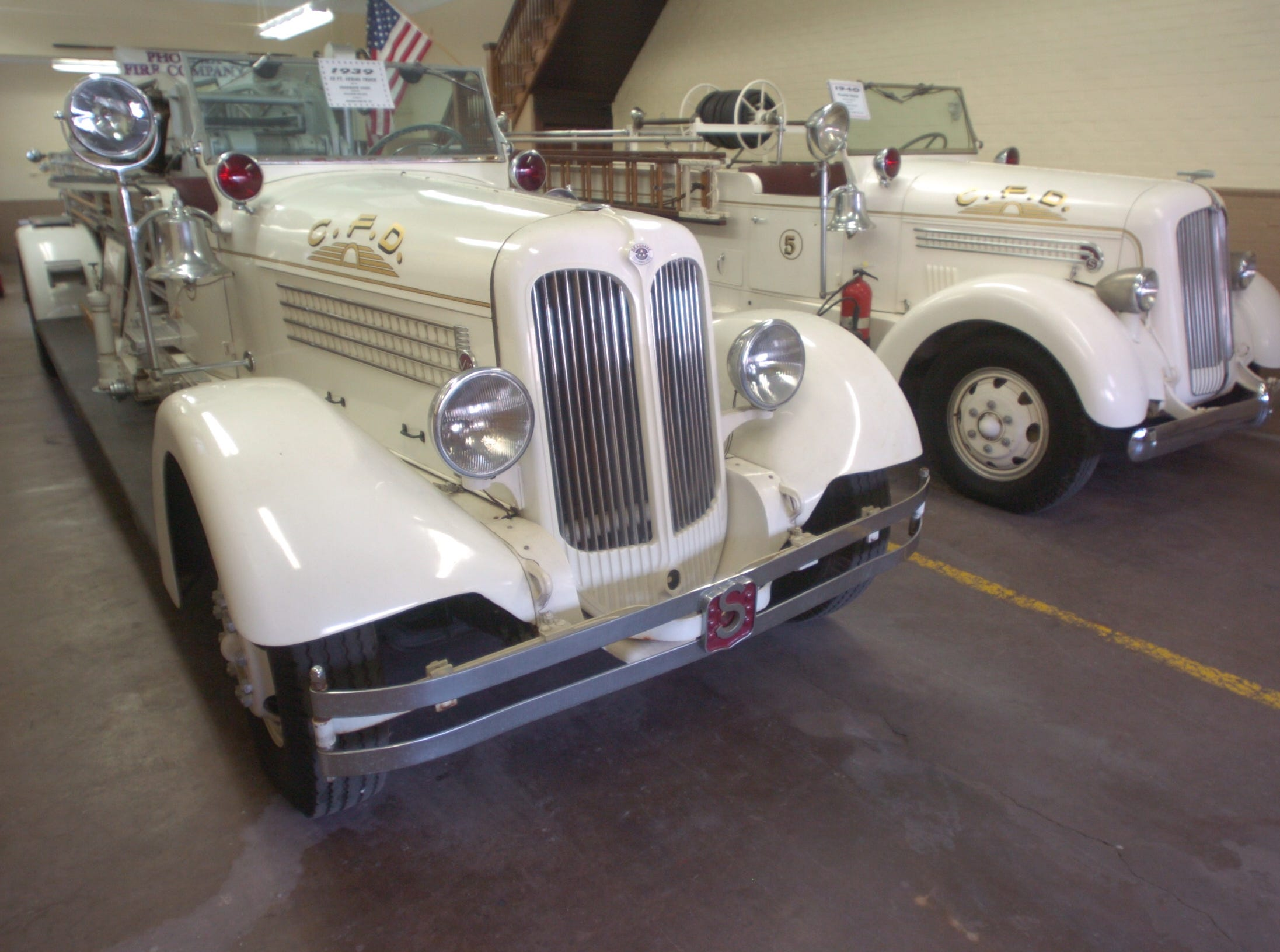 A 1938 aerial truck and 1940 pumper truck are among the historic fire equipment in the Phoenix Firehouse Museum on East Second Street.