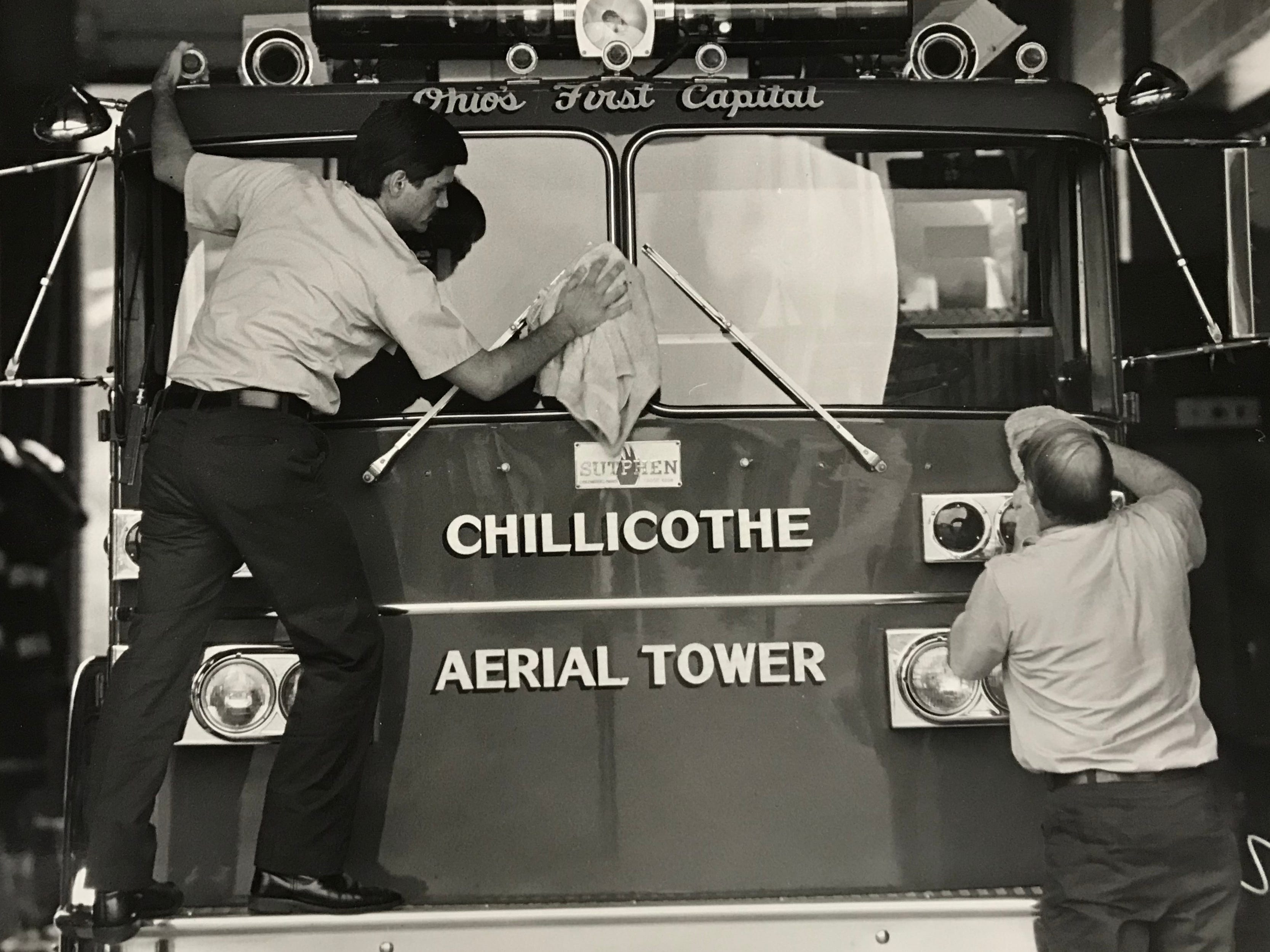 Chillicothe Firefighters Steve Barnes, left, and Vance Dearth clean the aerial tower truck in this undated Gazette file photo.