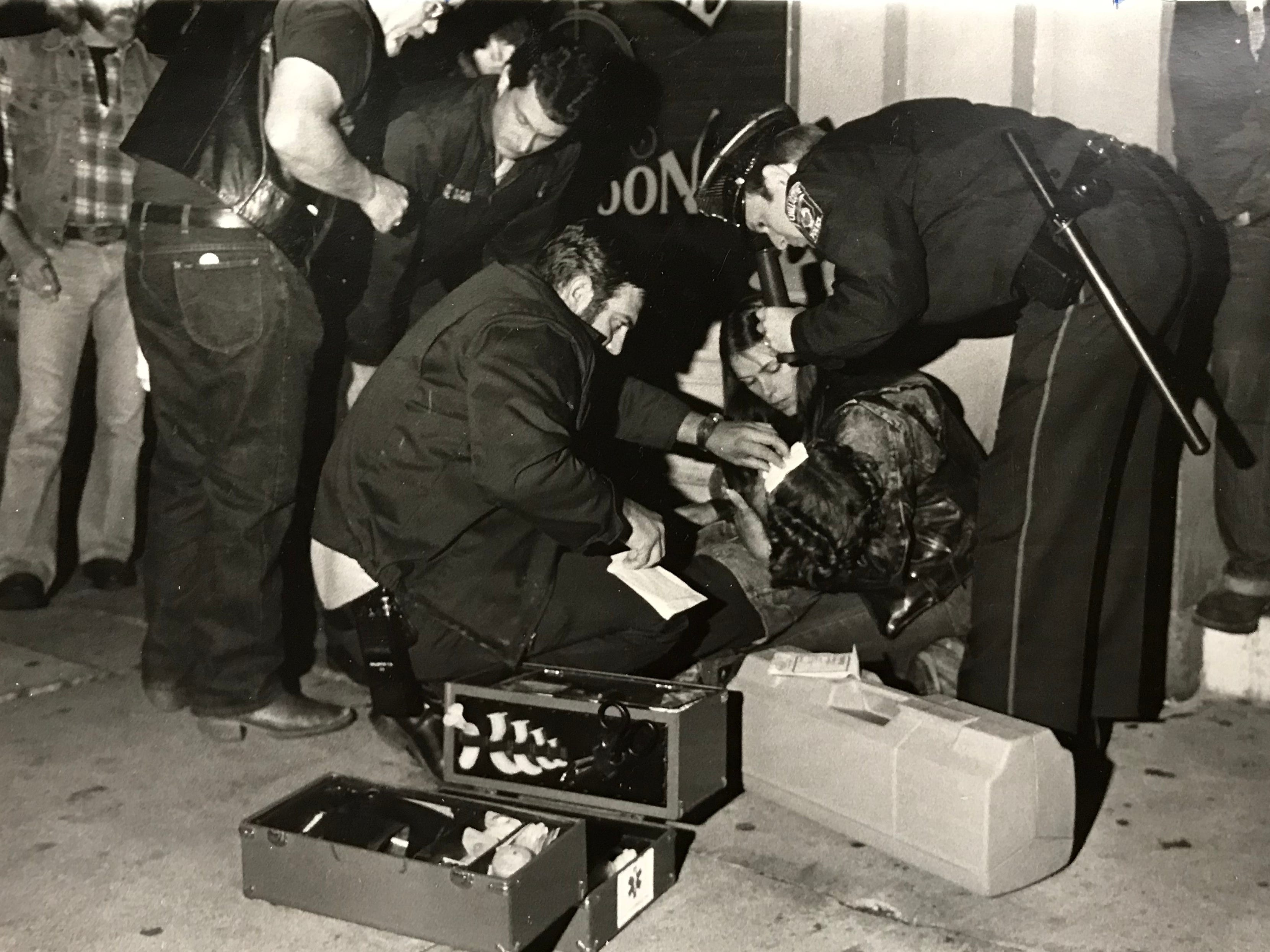 Chillicothe Fire Department and Police Department personnel tend to someone injured on a sidewalk in this undated Gazette file photo.