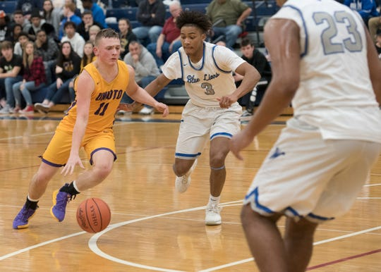 Unioto's Isaac Little drives to the hole during a Division II sectional final at Southeastern High School during the 2018-19 season.